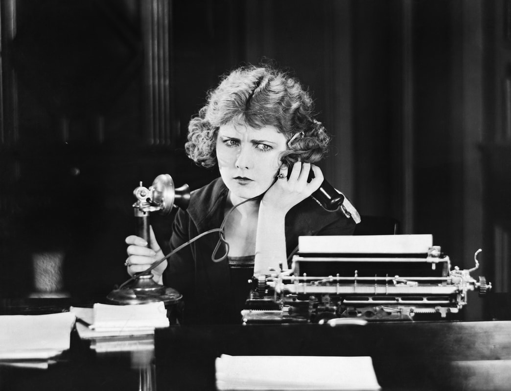 confused woman on traditional telephone