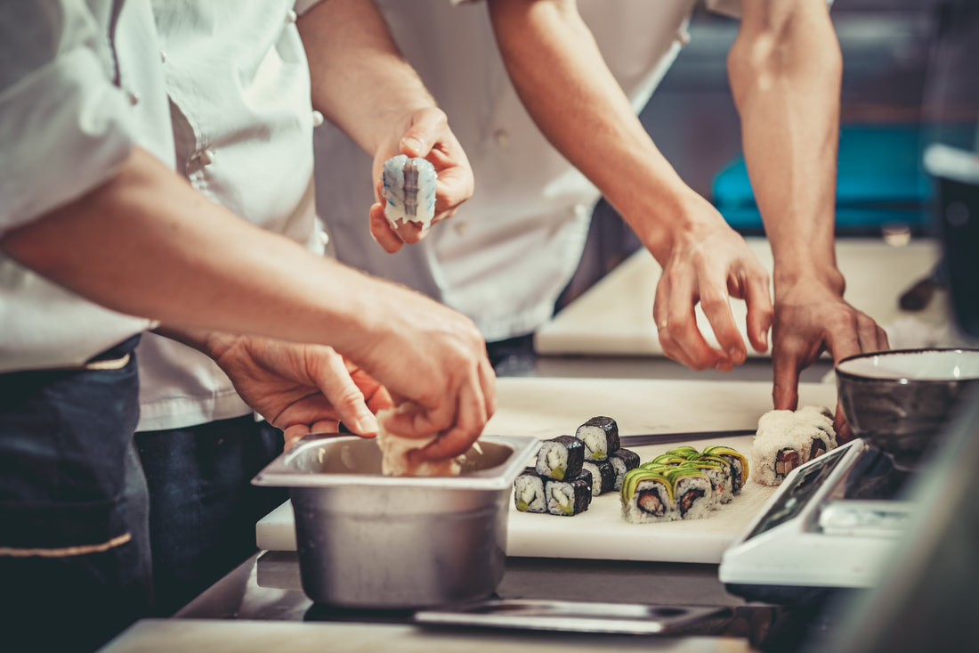 two sushi chefs cooking in kitchen ordyx pos blog post