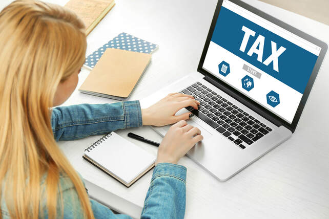 Girl on computer does taxes